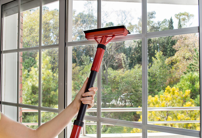 43885224 - close up of woman cleaning window glass with steam