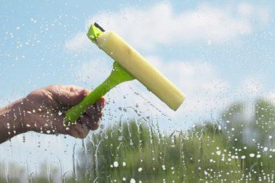 14126868 - human hand cleaning window