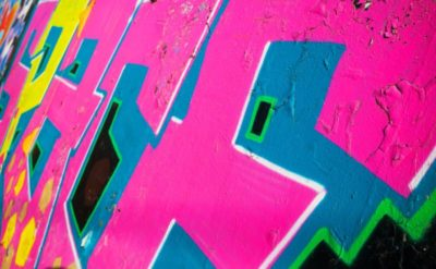 38693601 - abstract colorful graffiti fragment over old concrete wall