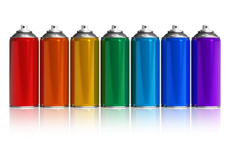 10759885 - set of rainbow paint spray cans isolated on white reflective background