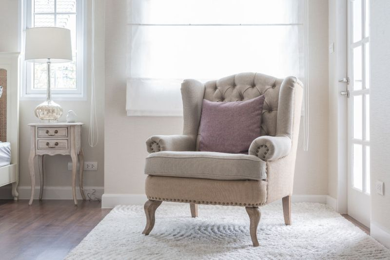47365036 - classic chair on carpet with pillow in bedroom