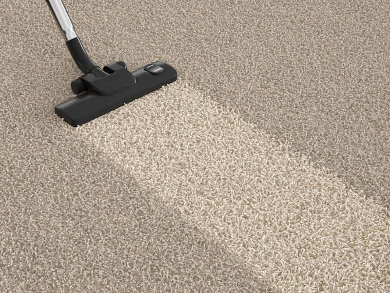 36570084 - vacuum cleaner  on the dirty carpet. house cleaning concept