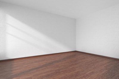 53585168 - empty room with dark hardwood parquet floor and walls with white textured wallpaper and sunlight from window, perspective view, 3d illustration