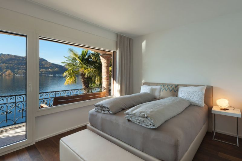 50592667 - nice bedroom with large window, view of the lake